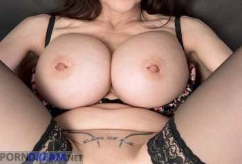 Chic milf with silicone Tits shows her pierced labia