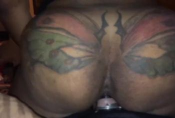 Girl with a big butterfly on the ass begs her hard fuck in pussy
